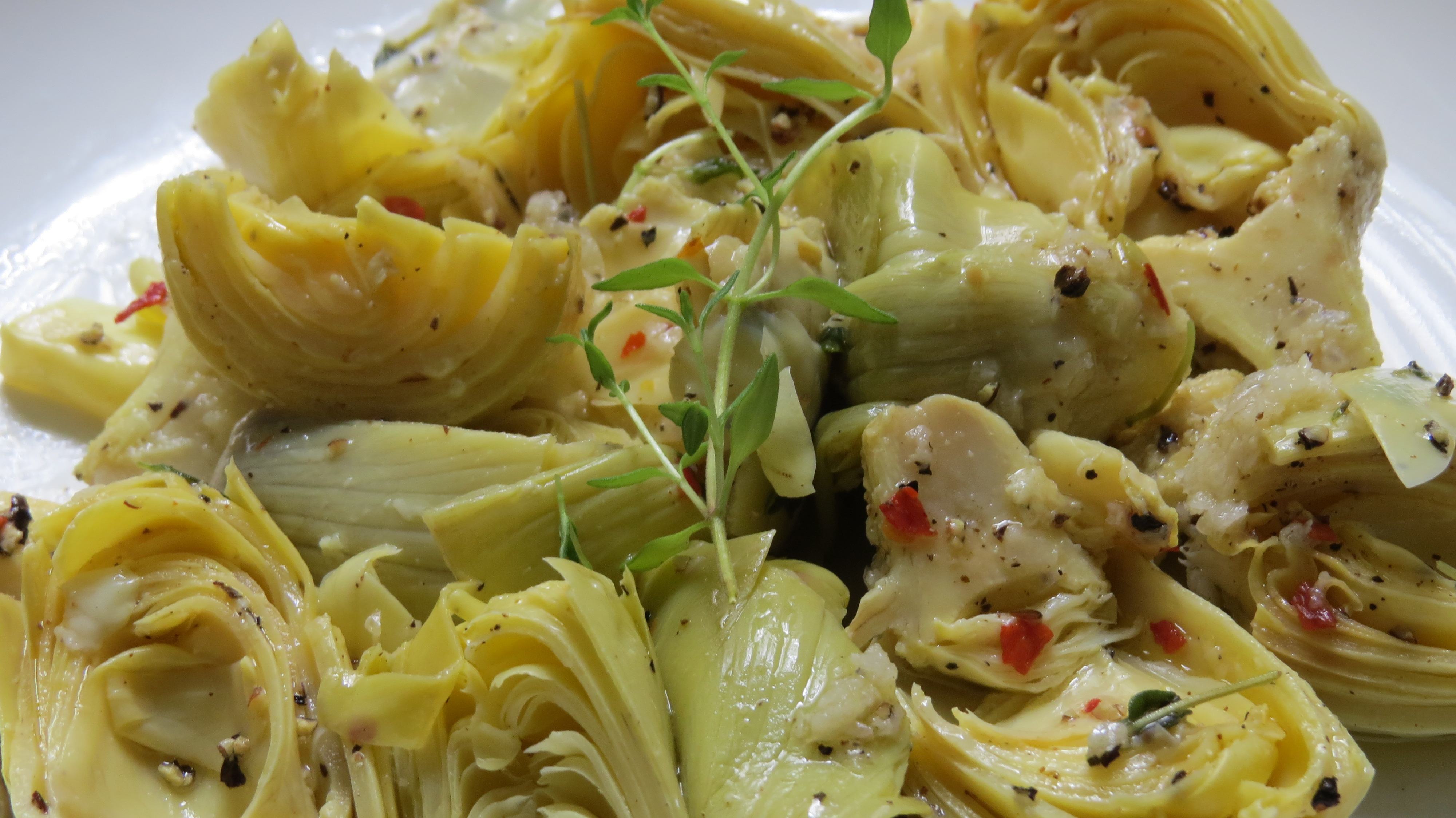 Close up lemon thyme marinated artichokes