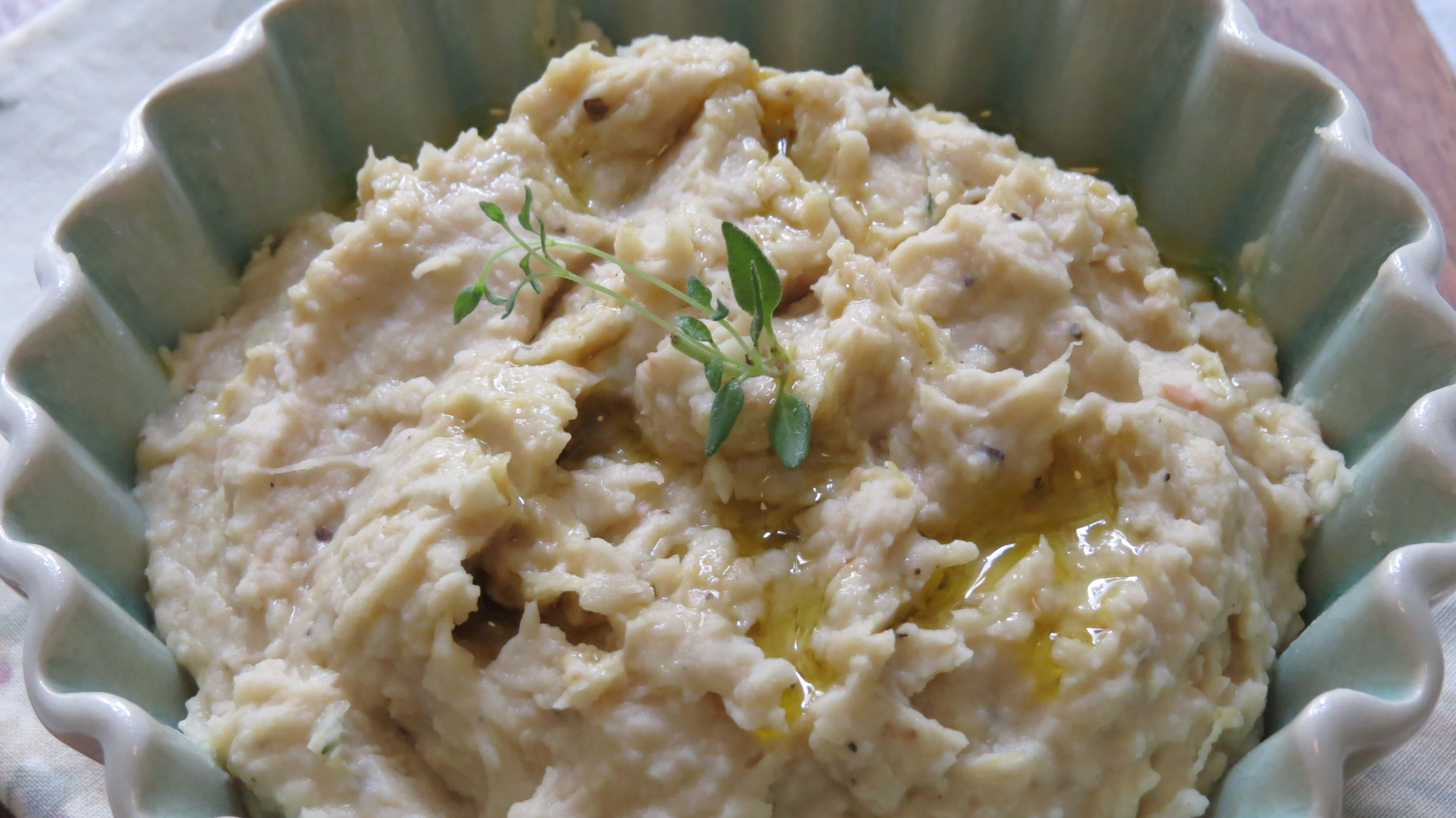 close up lemon thyme white bean dip